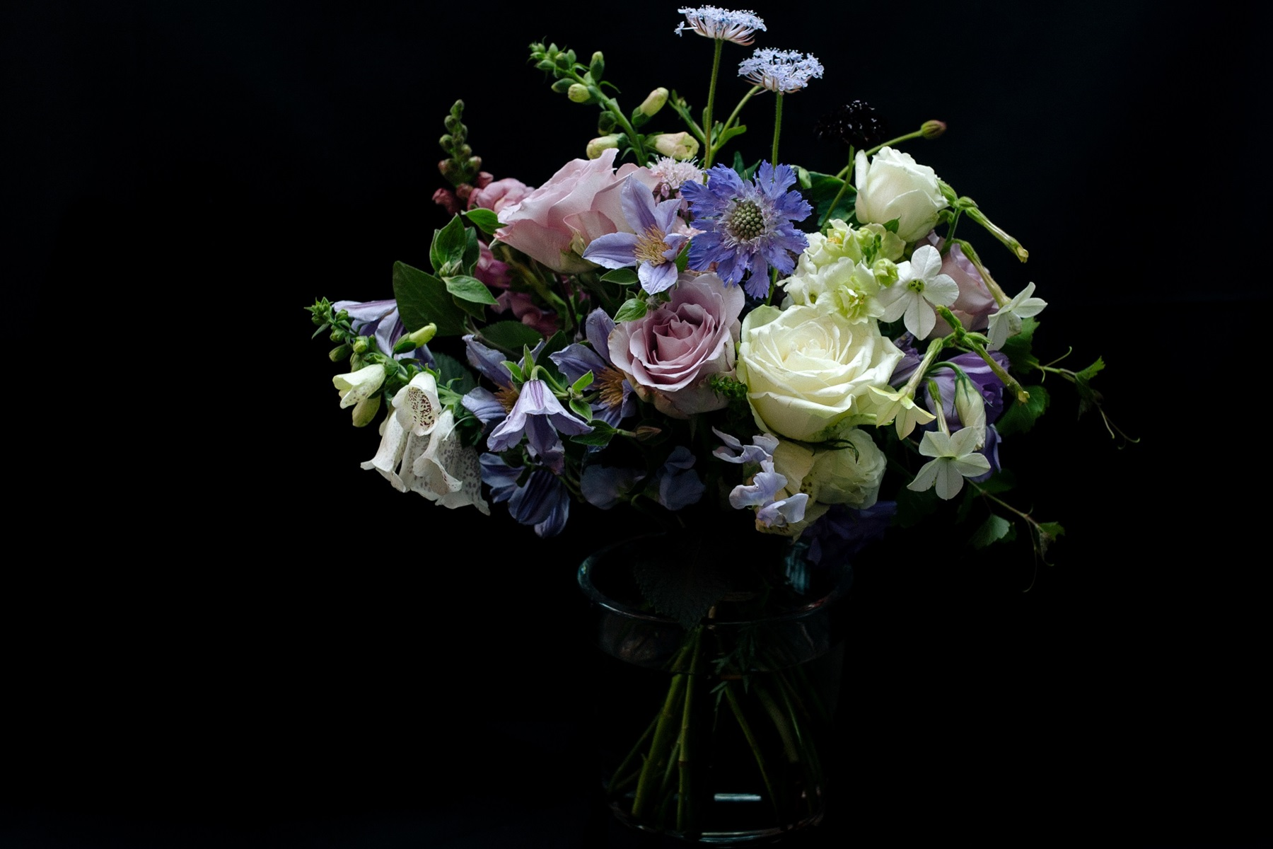 Bouquet flower arrangement of roses and clematis powdery color